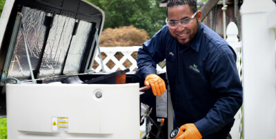 A technician working on a generator.