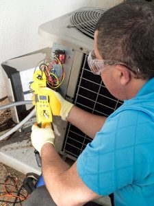 hvac-technician-repairing-air-conditioning-unit